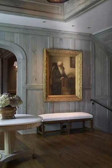 Entry Table, Love the Weathered Wood Walls, and Gild Frame artwork...Tracery Interiors
