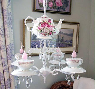 Teapot Chandelier is pretty & unique from Trash to Treasures at HGTV. Creating new uses for old junk.