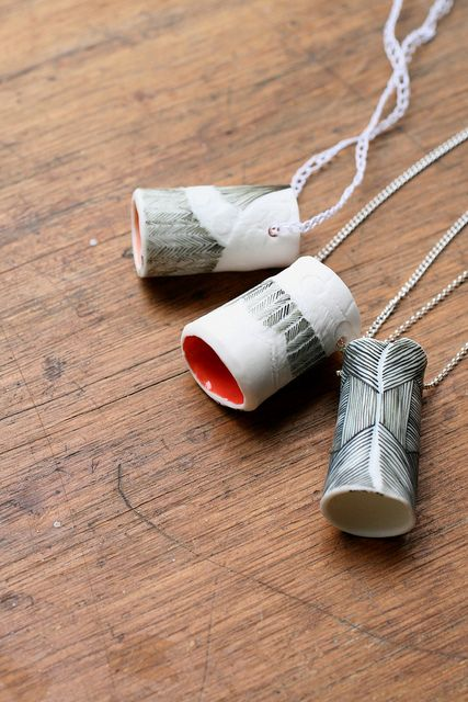 Golden Ink Collaborative.  Tube pendant necklaces from our exhibition 'Places and Spaces'