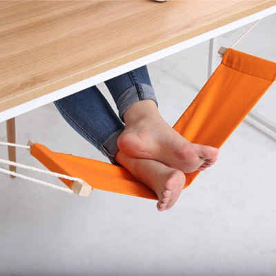 An under-the-desk foot hammock. I totally need this!!!!!!!!