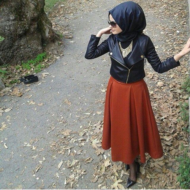 Burnt orange skirt and leather jackeg - check out: Esma <3