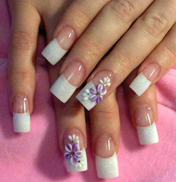 White French manicure tips with curved smile line, glitter overcoat and accent nails with 3D purple & white flowers, using 3D acrylic paint, free hand nail art