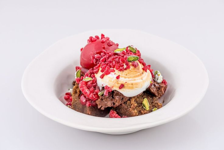 Beetroot and chocolate cake, toasted meringue , fresh and frozen raspberries, beetroot sorbet and candied pistachio