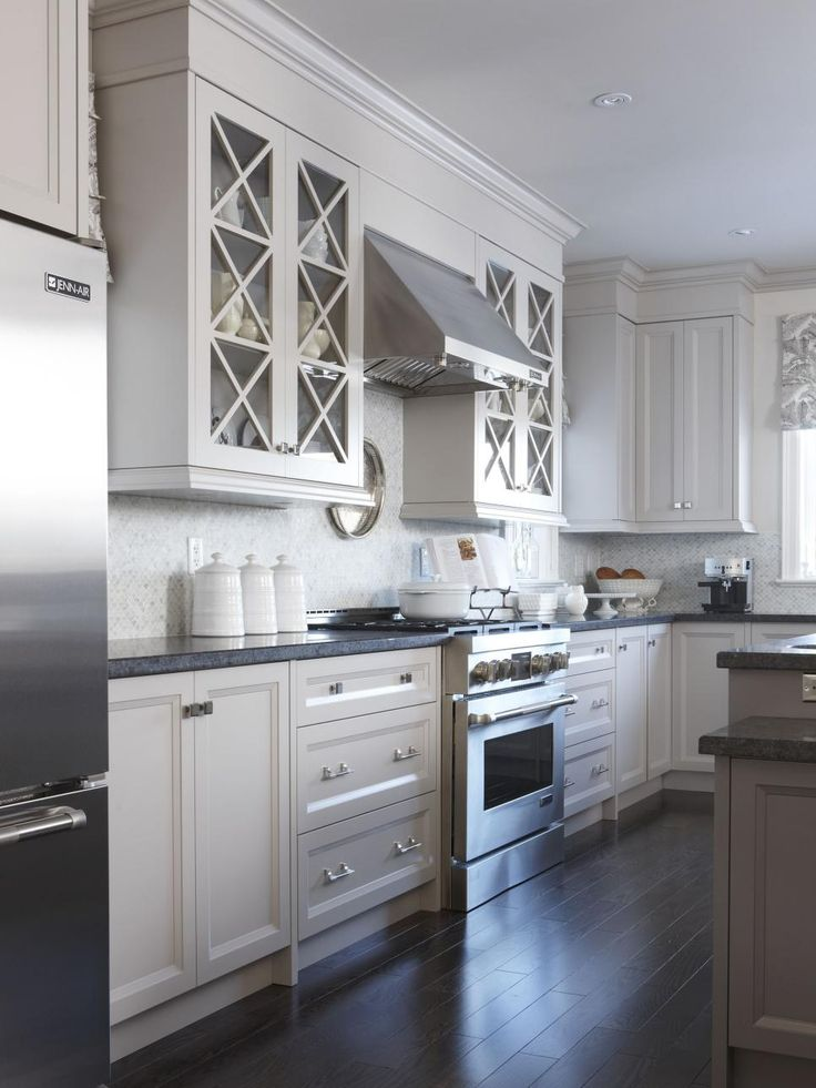 Molding stretched from the cabinet tops to the ceiling creates the look of custom cabinets at a fraction of the price.