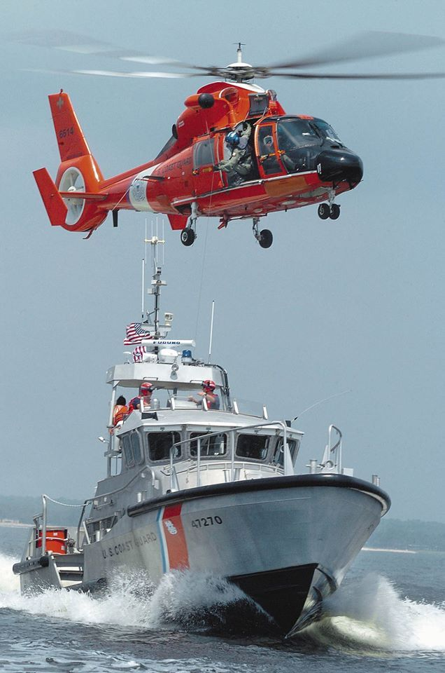 "A U.S. Coast Guard HH-65B ""Dolphin"" helicopter hovers over a Destin-based Coast Guard rescue boat n Choctawhatchee Bay during an air-sea rescue demonstration in this Aug. 25, 2005, Daily News file photo."