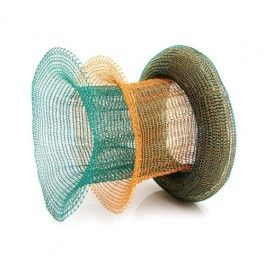 Mesh Bracelet - Handcrafted Danish Design. The layers of woven blue-green and 18-karat gold in award winning artist Lisbeth Dauv's Mesh woven, lacquered copper Mesh bracelet look like something a mermaid would wear. The colours are reminiscent of the salt air and crashing tide at the beach, while the shape and versatility of this rolled bracelet evoke ease and motion. This beautiful bracelet is the perfect statement jewellery for any occasion. http://www.nuuru.com/en/mesh.html