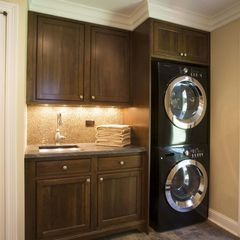 Could do this. Like cabinet for w/d. So much cleaner looking. Like under cab lighting. Would need to switch cabinet where sink is so a counter top could run under window. Would likely remove doors in cab above w/d to put a basket. Should I relocate sink to right of w/d so I don't need to move connectors in wall?