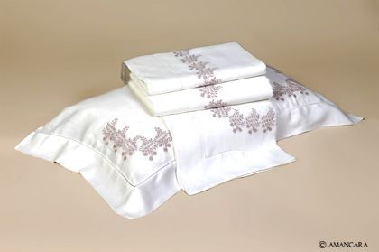 White linen #sheet set with delicate lavender embroidered flowers.