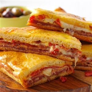 Hot Antipasto Sandwiches Recipe -I usually make this popular dish as an appetizer for holiday get-togethers. But I also like to serve it with salad as a satisfying meal. —Lisa Berry, Fayetteville, West Virginia