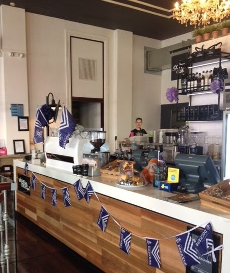Showing their colours for the AFL finals - The Coffee Club Fremantle
