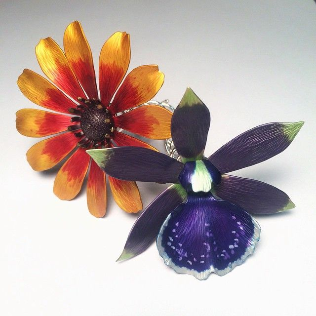 """Two more hairpins finished today! Today's flowers are a bolopetalum midnight blue """"cardinal's roost"""" orchid and a black-eyed Susan. Both are made from anodized aluminum with sterling silver for the pins."""