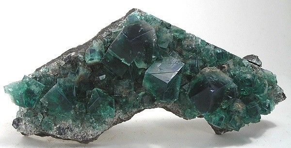 Fluorite, Rogerley Mine, Frosterley, Weardale, North Pennines, Co. Durham, England, UK, Cabinet, 12.3 x 5.5 x 2.9 cm, A plate of FINE, GEMMY fluorite twins from older finds at the Rogerley., For sale from The Arkenstone, www.iRocks.com. For more details on this piece and others, visit http://www.irocks.com/minerals/specimen/21055