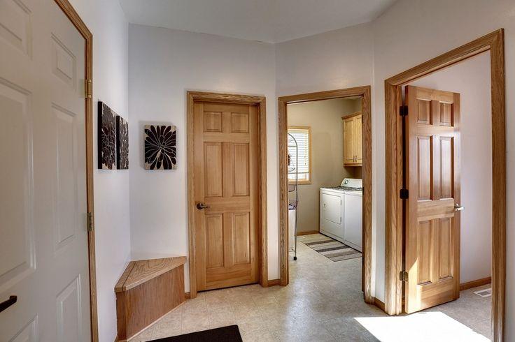 Contemporary Hallway with travertine tile floors
