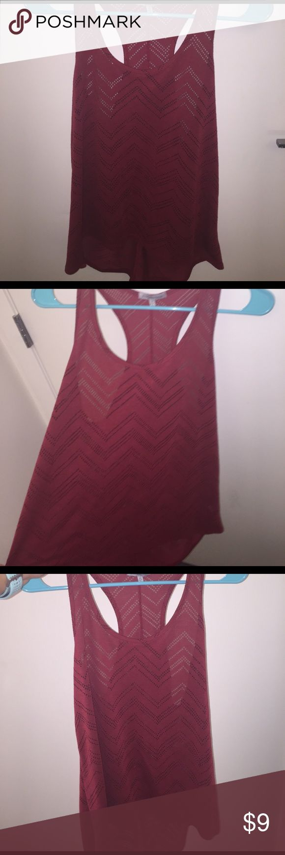 Burgundy chevron see through tank top Burgundy/ Maroon colored tank top with a chevron pattern that is slightly see through. never worn!! Charlotte Russe Tops Tank Tops