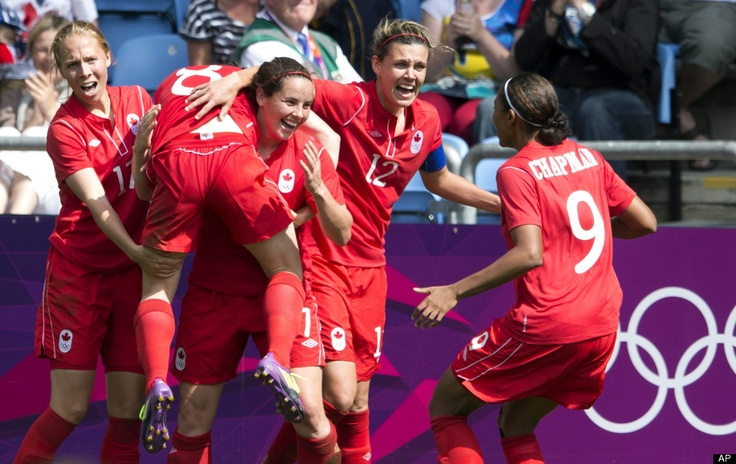 Canada's Christine Sinclair (12), Rhian Wilkinson (7) and Brittany Timko, left, hoist teammate Diana Matheson into the air after she scored the game-winning goal against France, as teammate Candace Chapman (9) joins the celebration at the bronze medal women's soccer match at the 2012 London Summer Olympics, in Coventry, England, Thursday, Aug. 9, 2012.