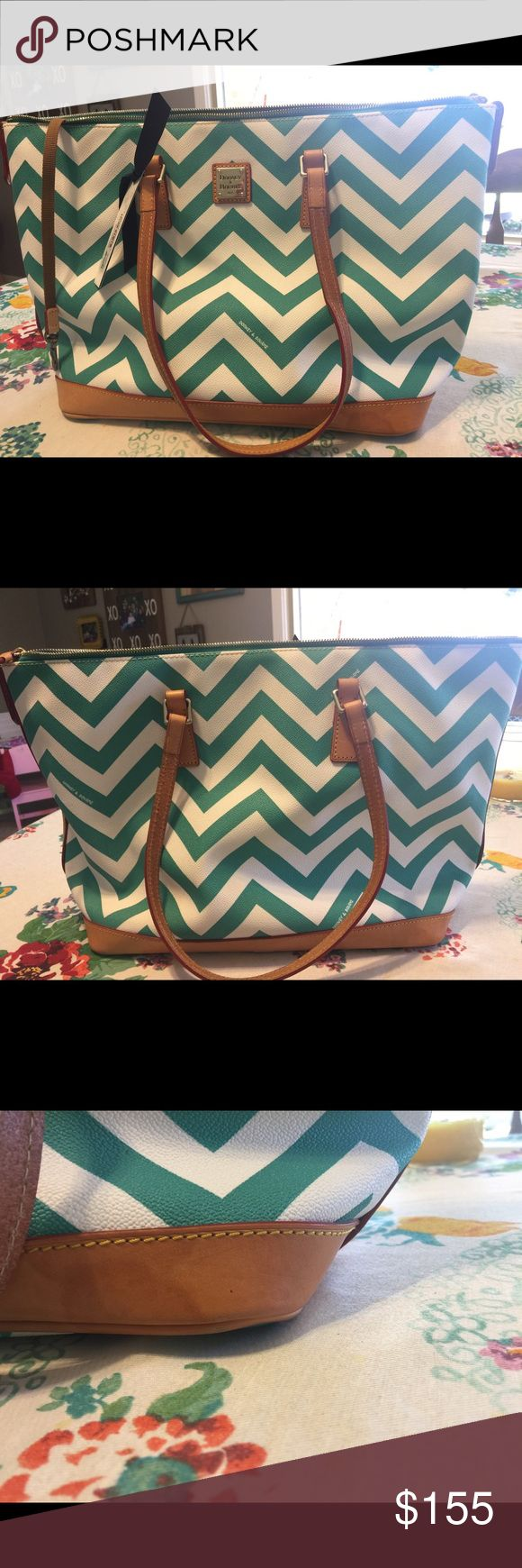 """Dooney and Bourk Chevron Teal tote and coin purse. * Chevron teal  * All over  Sea foam Chevron stripe,double straps, metal-plated logo, zipper closure with tassels, goldtone hardware, four bottom feet * Back-wall zip and slip pockets, two front-wall slip pockets, key keeper * Measures approximately 17-1/2""""W x 11-1/2""""H x 6""""D with a 9"""" strap drop; weighs approximately 1 lb, 9 oz * Body 81% PVC/19% cotton; lining 100% cotton * Imported.     ***** bottom of tote does have water spots but not…"""