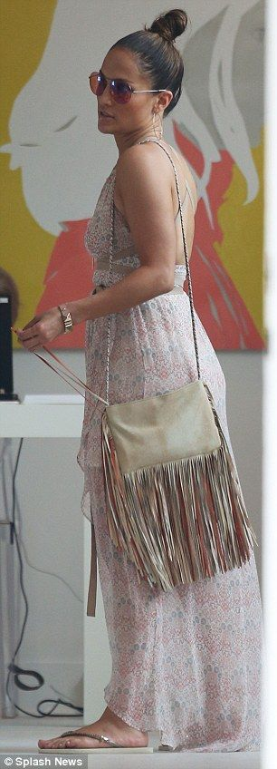 Boho: The mother-of-two displayed her free-spirited side with a fringed shoulder bag...