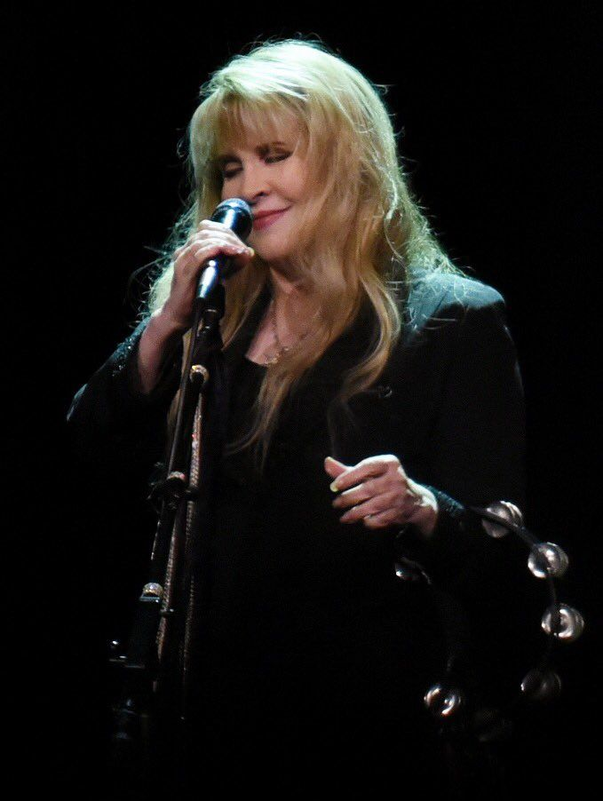a charming photo of Stevie  ~ ☆♥❤♥☆ ~   onstage, her tambo on her left arm on the opening night concert in Phoenix, AZ on October 25th, 2016 during her '24 Karat Gold' Tour, 2016; photo by Bily Foster