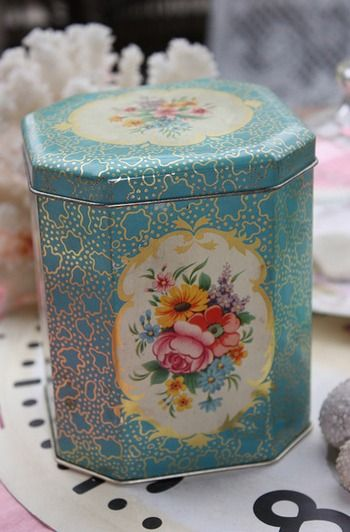 vintage tin......we like pretty tins in our family and the more vintage, the better