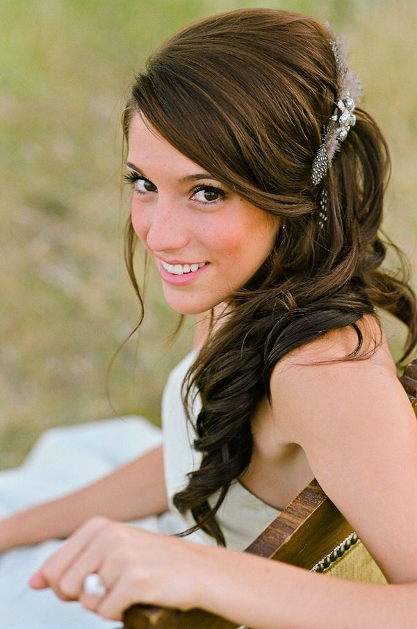 half up, side part curled hair, maybe with a braid too