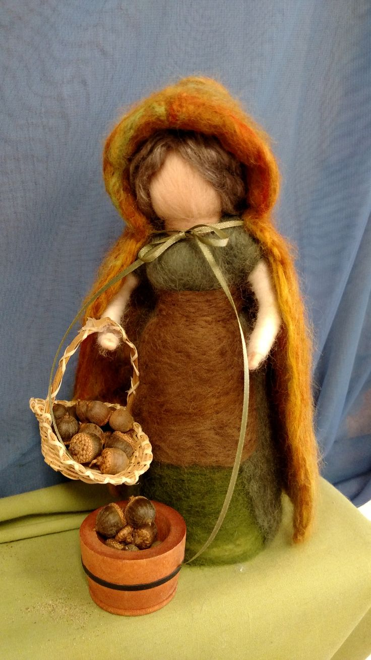 Wonderful, handmade, Waldorf-inspired, needle felted Mother Nature figure with her autumn cloak on! This is the center figure of my nature table in my preschool classroom right now :). If you are interested in any of my work or would like to make your own custom order, please contact me at terisfairies@gmail.com!
