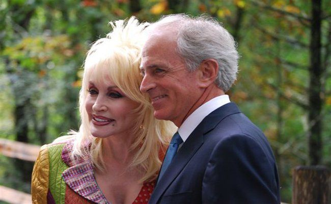"Dolly Parton and Carl Dean - The country music legend and her husband, Carl Dean, recently celebrated their 50th wedding anniversary—an incredible feat within the world of music and fame. The two met in their early 20s in front of a Laundromat in Nashville. They dated for two years and were married on May 30, 1966. Parton wrote her hit song ""From Here to the Moon and Back,"" in honor of her lasting love for Dean."