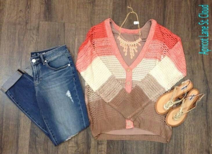 Sunsets At The Beach ‪#‎SB3132‬ This color blocked open work cardigan reminds me of a beautiful sunset and beach colors. There's beautiful coral, pink, ivory, tan, and brown in the different blocks. We layered a brown NikiBiki tank top underneath and it pairs perfectly with our cuffed distressed skinnies. A gorgeous gold and light pink statement necklace picks up the light pink trim and the light pink blocked section. To complete this look we added our gold metallic sandals. This sweater…