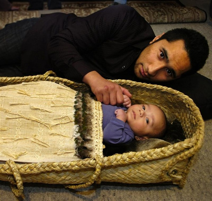 Jamahl Collins in Dunedin, yesterday with son Te Apanui Ryder-Uiti (9 weeks) in a traditional wahakura, woven by Roka Ngarimu-Cameron. Photo by Jane Dawber.