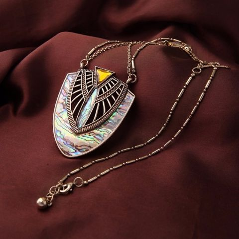 This intricately designed shell neck piece will make you stand out in the crowd!