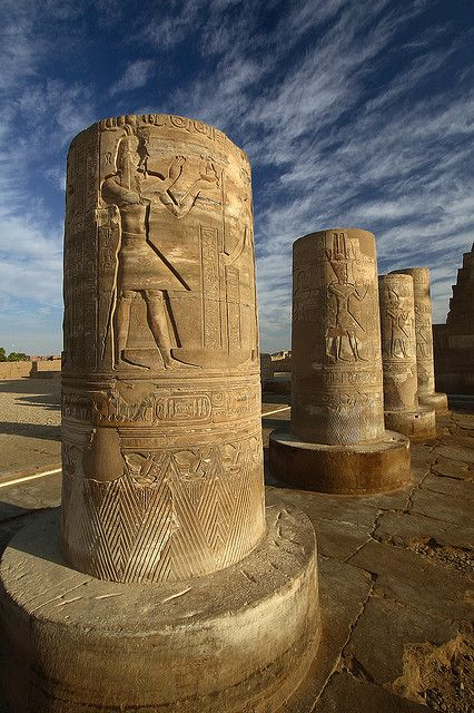 """Temple of Kom Ombo, Egypt is an unusual double temple built during the Ptolemaic dynasty (180-145 BC) in the Egyptian town of Kom Ombo. The southern half of the temple was dedicated to the crocodile god Sobek, god of fertility and creator of the world with Hathor & Khonsu. the northern part of the temple was dedicated to the falcon god Haroeris, also known as Horus the Elder, along """"with Tasenetnofret (the Good Sister, a special form of Hathor) and Panebtawy (Lord of the Two Lands)…"""