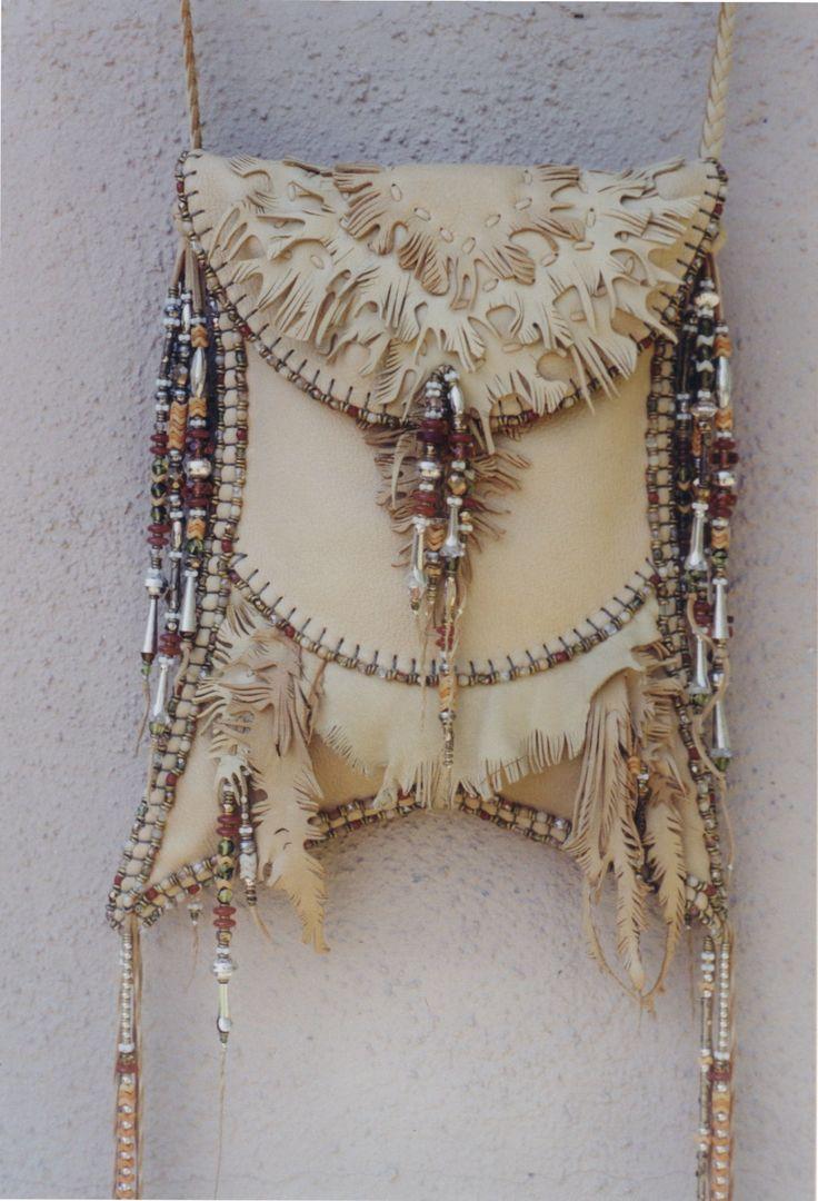 Swallow Tail fancy cut work deerskin bag by Carole Hook.