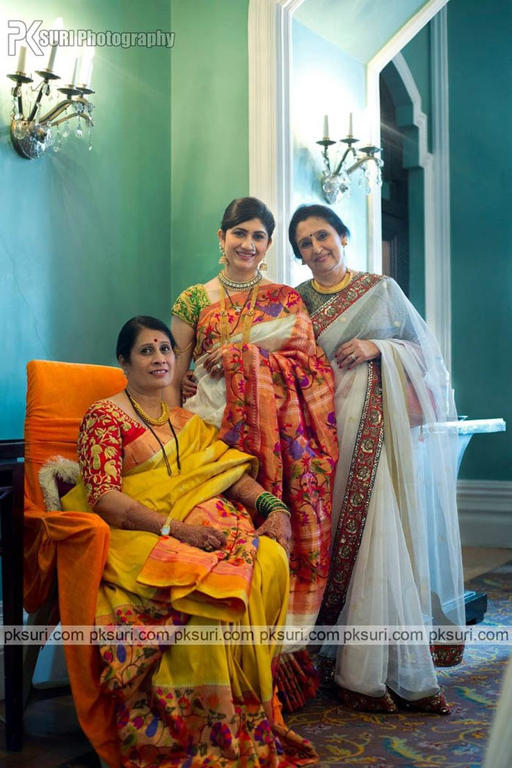 Family of the bride posing royally dressed in ethnic saree