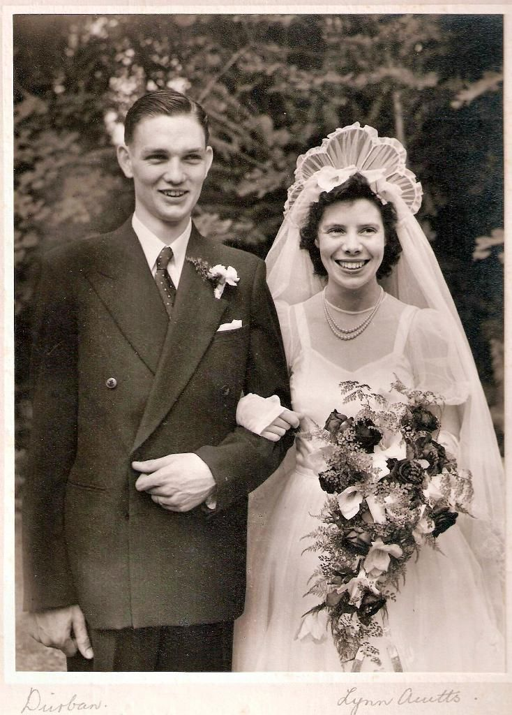 1948 bride and groom ... interesting headpiece.