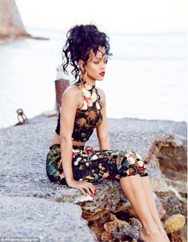 Elegant: The Barbadian beauty Queen Rihanna was graceful as she looked out at the sea    8      4