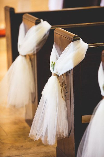 Wedding ceremony aisle marker idea - white tulle wrapped around church pews {Emily Joanne Wedding Films & Photography}