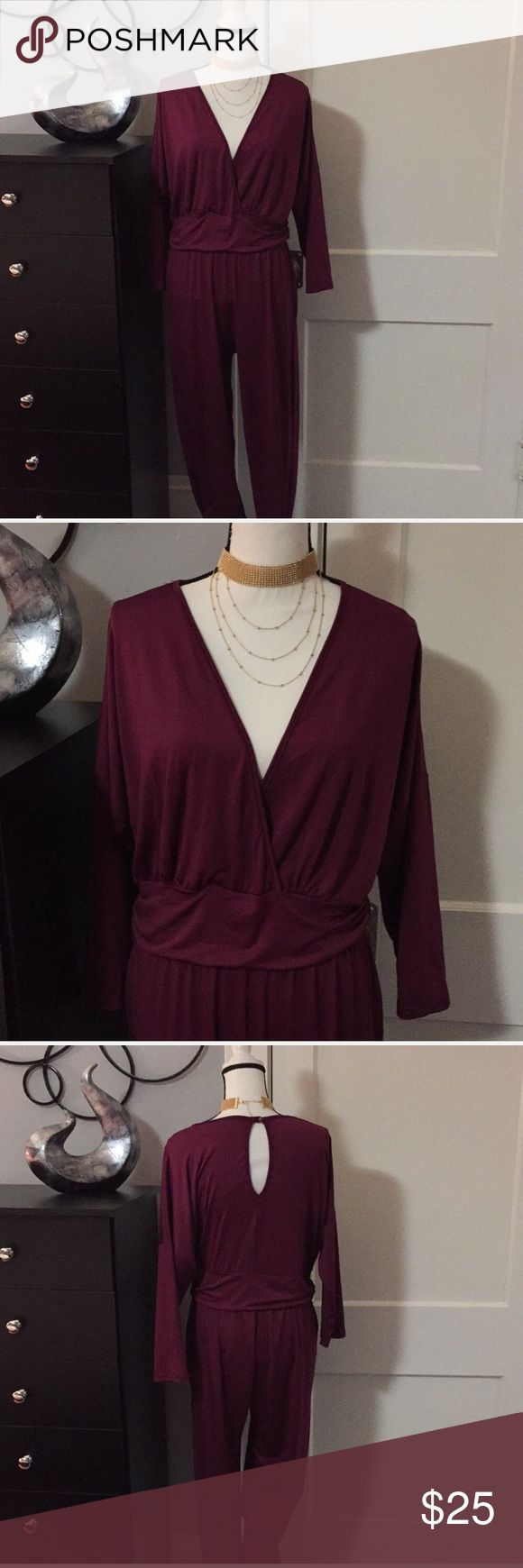 ⚡️Flash Sale⚡️ Burgundy Jumpsuit Sz 1x Burgundy Jumpsuit Sz 1x  Size tag missing but positive this is a 1x Very stretchy and lightweight.  27' Inches From armpit to armpit 17' Inches laid flat waist (unstreched)  30' Inches inseam. ****Necklace Not For Sale***** unbranded Pants Jumpsuits & Rompers