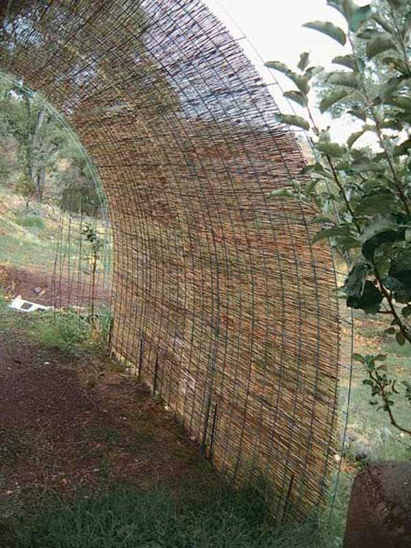 2. Lay water reed mats over panels used for fencing to create a shade screen.