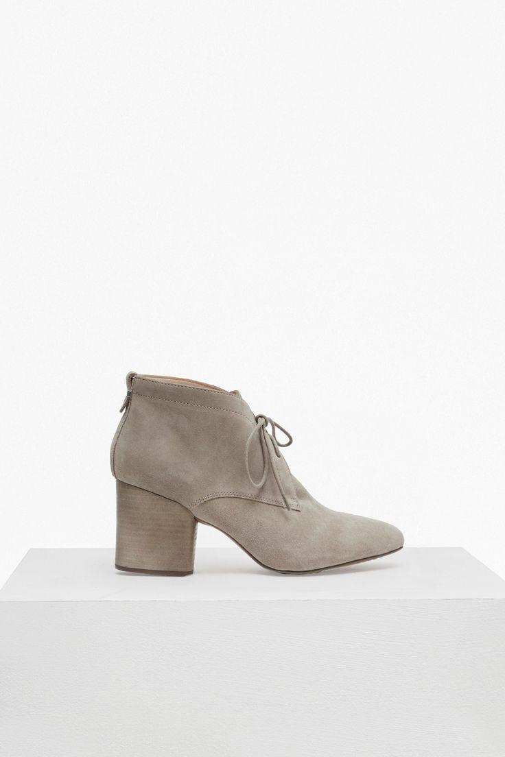 <ul> <li> Suede leather boots</li> <li> Suede upper</li> <li> Stacked block heel</li> <li> Front lace-up fastening</li> <li> <strong>Heel height</strong>: 8cm</li> </ul>