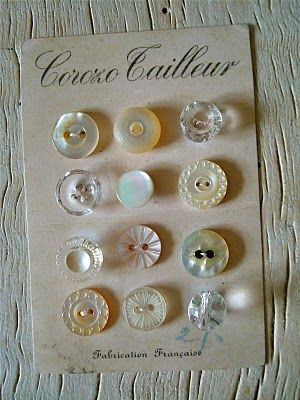 Beautiful little button collection displayed on a button card....pearl buttons......
