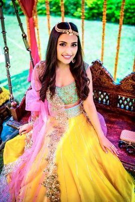 Mehendi Outifit - Yellow and Blue Lehenga | WedMeGood | Bright Yellow and Aqua Blue Lehenga with Pink Net Dupatta with Embroidery on Border #wedmegood #indianbride #mehendioutfit #mehandi #yellow #indianwedding #yellow
