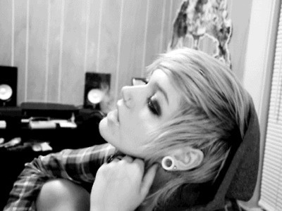 like the gauges, on a cute girl. good hairstyle also.