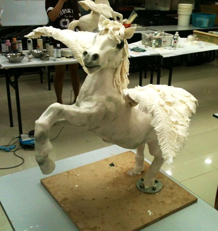 - 3D sculpted pegasus with pound cake, modeling chocolate and fondant. http://www.facebook.com/thekarencuppycake