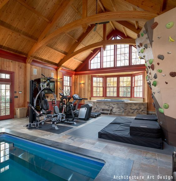 The ultimate home gym! Beautiful high wood ceilings with  red trim. State of the art workout equipment, along with a hot tub, pool and seriously cool bouldering wall!