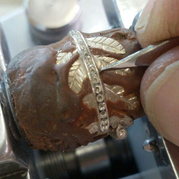 This is how the cz stones are set in the leaf engagement ring by a proffessional stone setter, who is a true artist
