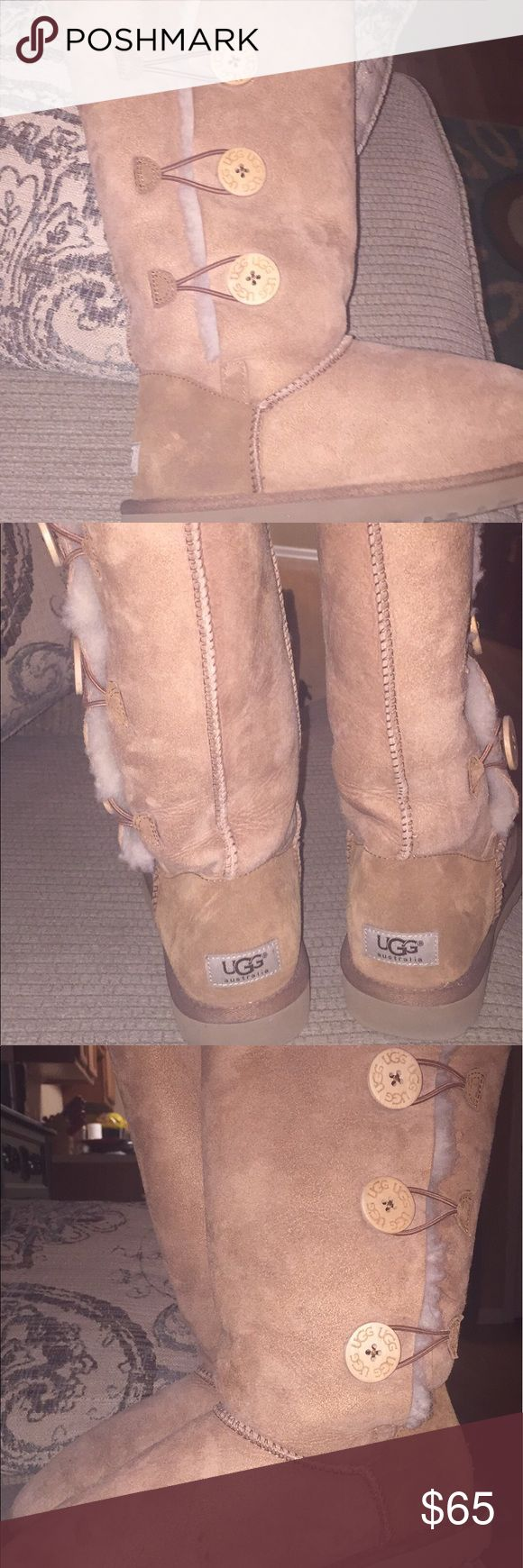 Authentic Australian UGGS These are authentic triple button UGG boots. Used a few times, but in pretty good condition. Has a minor stain on the front, but it's barely noticeable! UGG Shoes Winter & Rain Boots