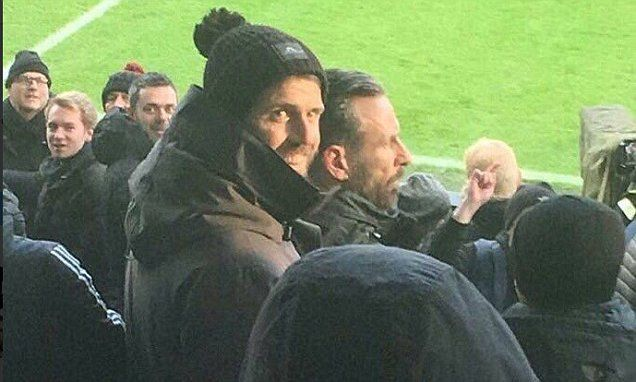 Michael Carrick supports team-mates in the away end