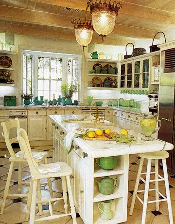 white kitchen with green and blue dishes and accessories, love the light fixtures