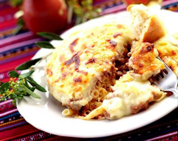 "Pastisio (""παστίτσιο "") - a baked pasta dish with a filling of meat on the bottom and a Bechamel sauce on top"
