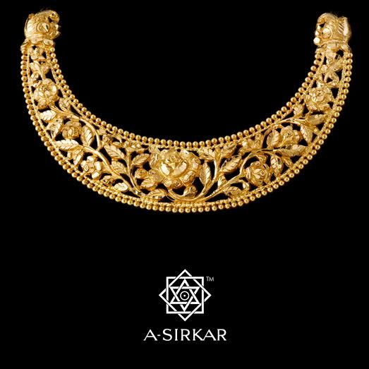 Bengal Rose Hansuli: This inverted arbour of climbing golap is perforated and has a border of hollow-ball sabudanas ; half-makars hold up the ends ; and it's left natural gold. Here, for the New Year, exquisitely hand-chased in rich 22K gold, in remembrance of a Bengal past and in hope for a glorious Bengal to come, we present you the Bengal Rose Hansuli.