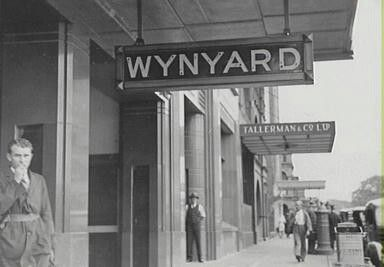 Entrance to Wynyard Railway Station in Sydney in 1933. Looking north along York St near Margaret St. •City of Sydney Archives•